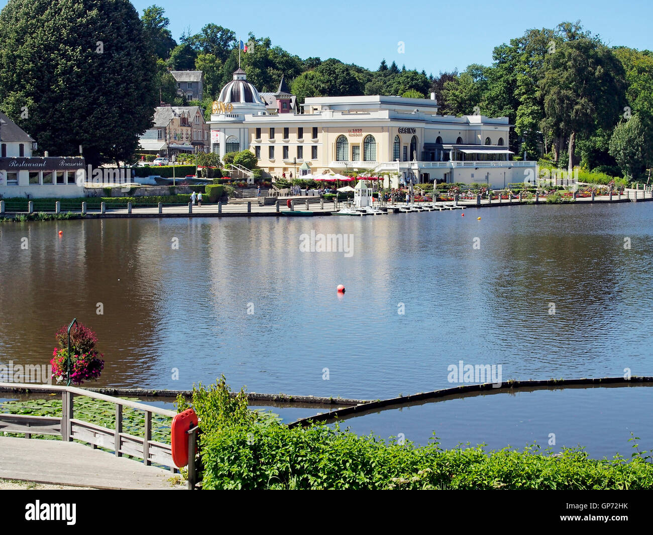 The lake, Casino and Casino Gardens in late summer in the old spa resort of Bagnoles de L'orne in Normandy, France. Stock Photo