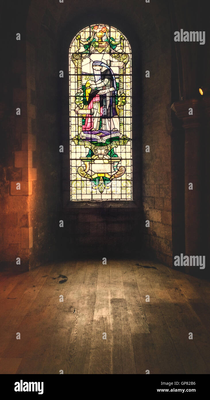 cathedral room with beautiful stain glass window Stock Photo