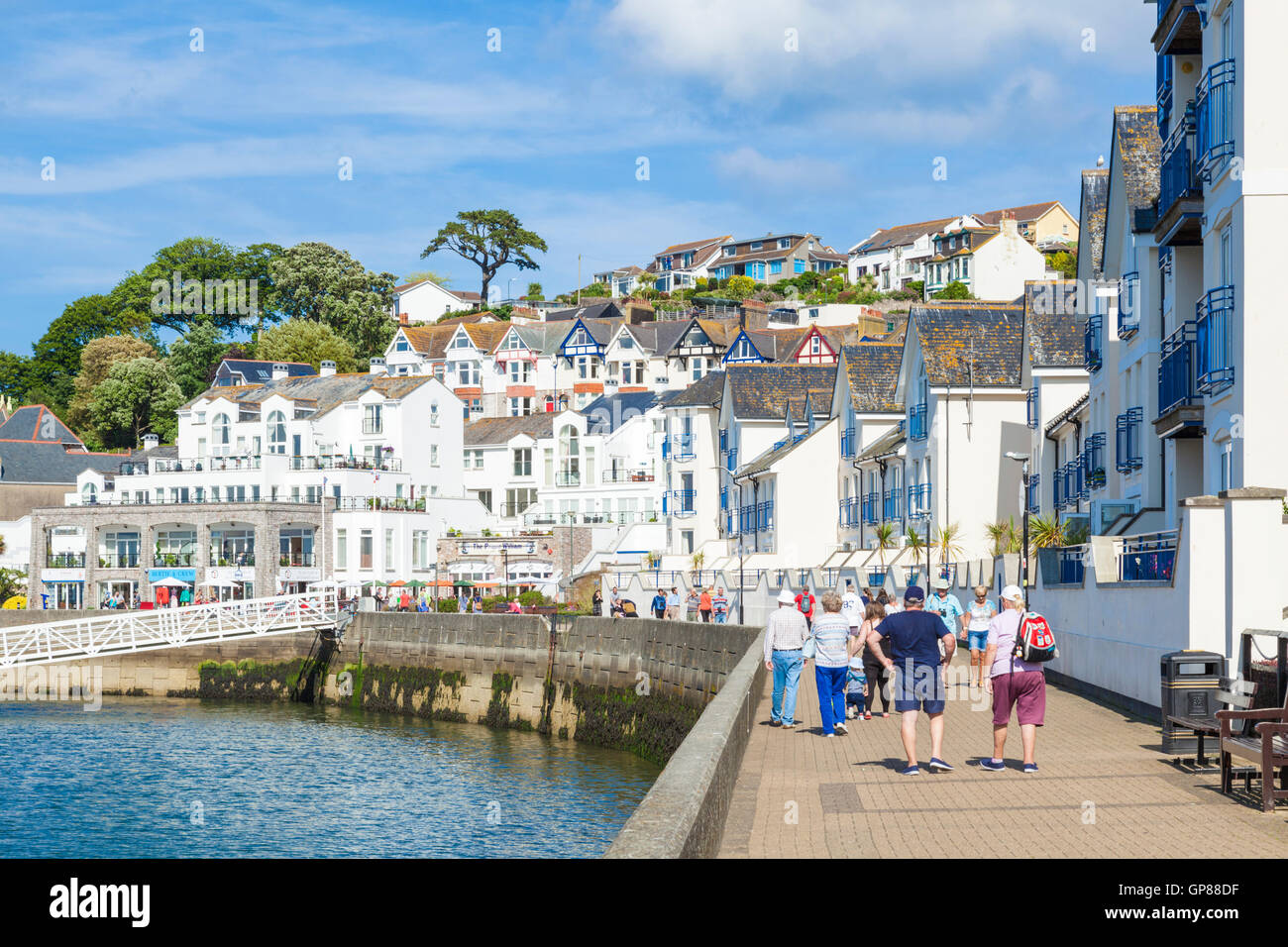 Holiday makers on Brixham Quay Brixham Devon England UK GB EU Europe - Stock Image