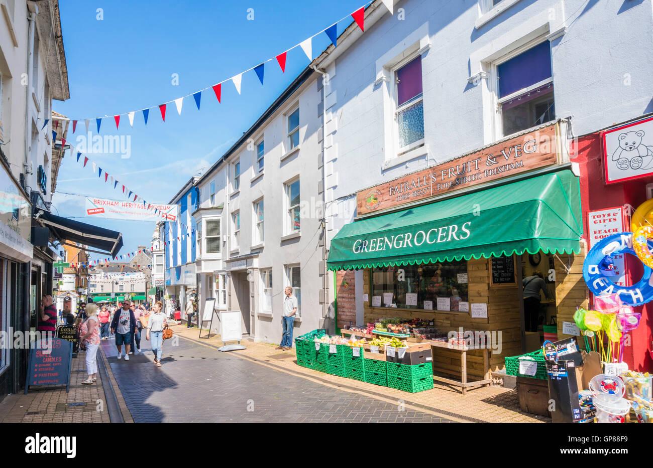 Shops on Fore Street Brixham Devon England UK GB EU Europe - Stock Image