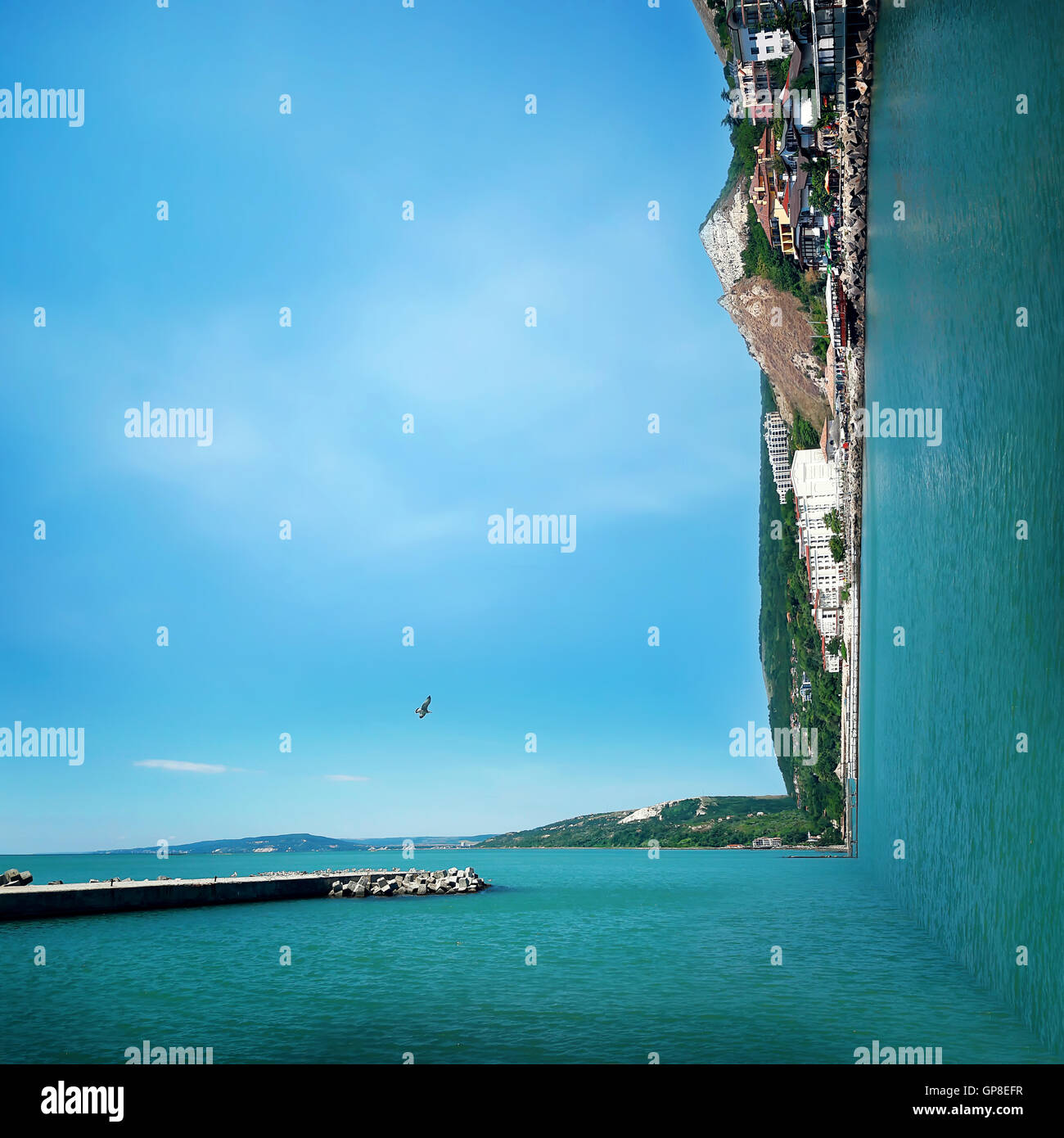 Surreal background of two worlds collide at the coast of the sea. Sea landscape journey and vacation concept. Stock Photo