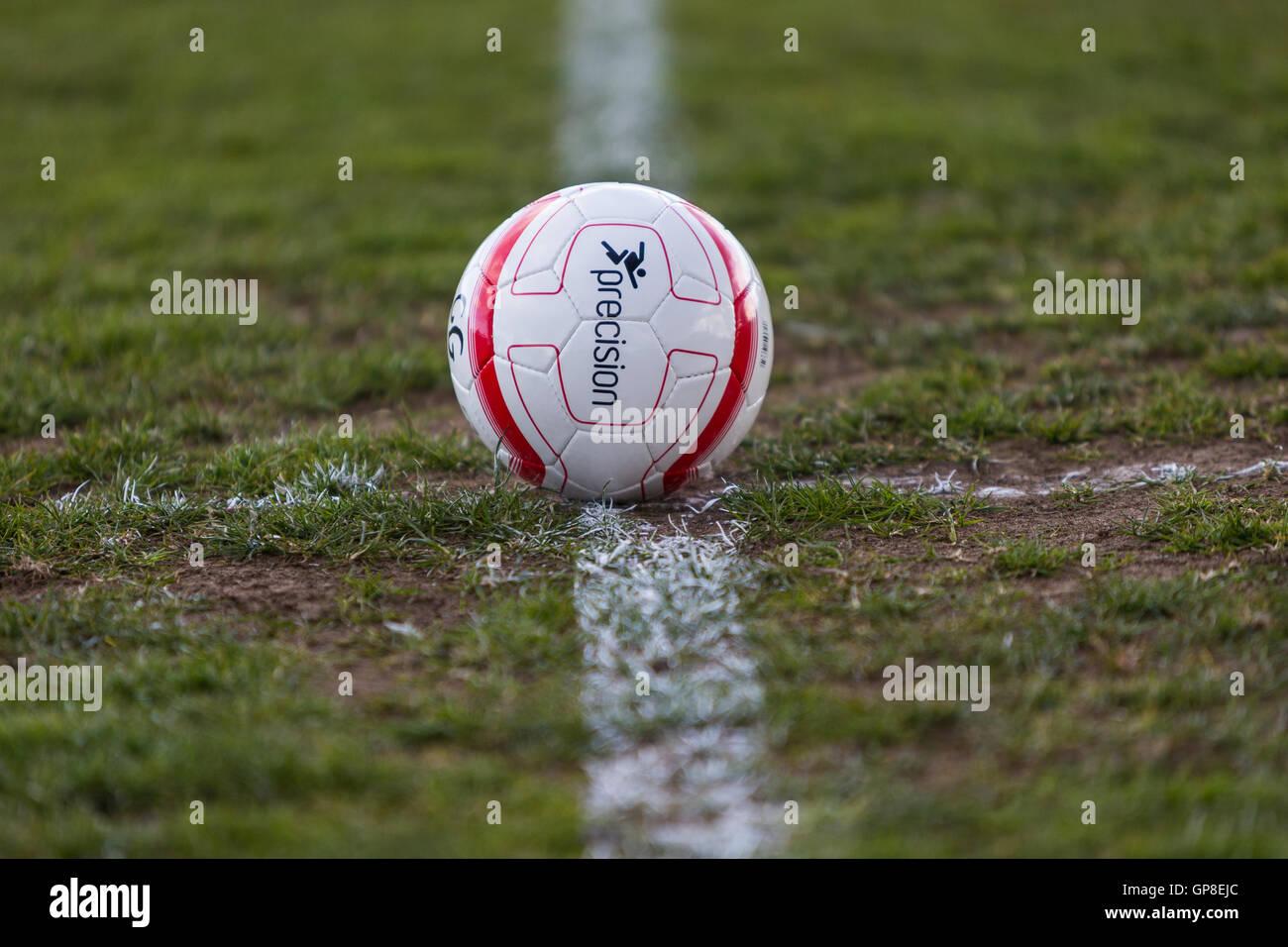 Football on the halfway line awaiting the game kick off - Stock Image