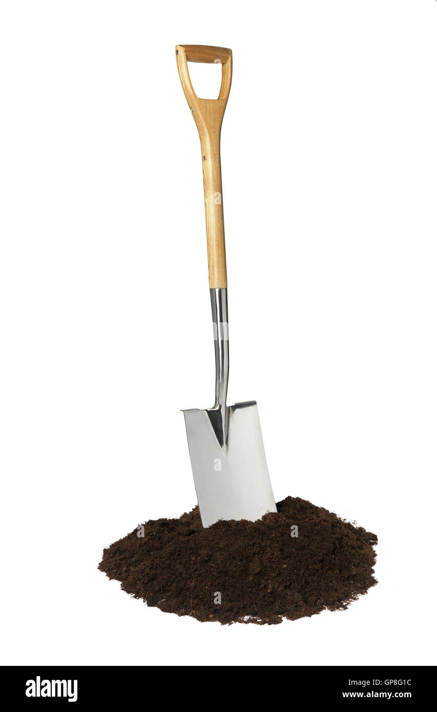 A garden spade with soil shot in a studio shot isolated on a white background - Stock Image