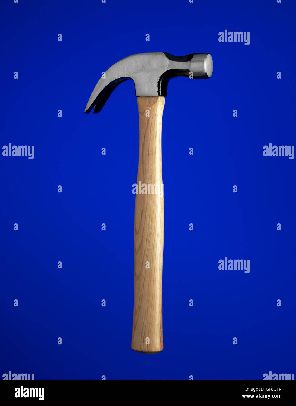 Claw hammer with a blue background - Stock Image