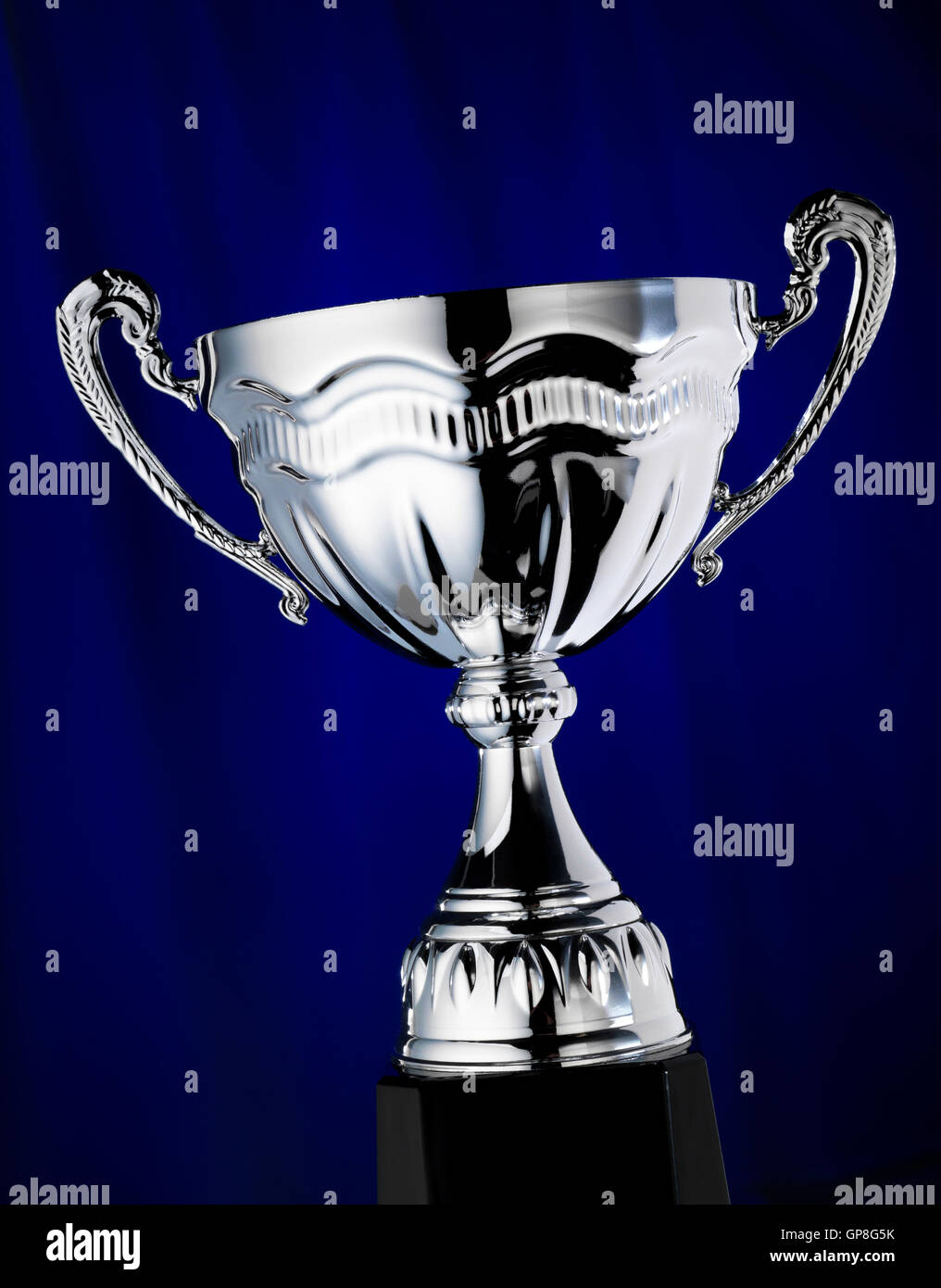 Trophy with a blue background - Stock Image