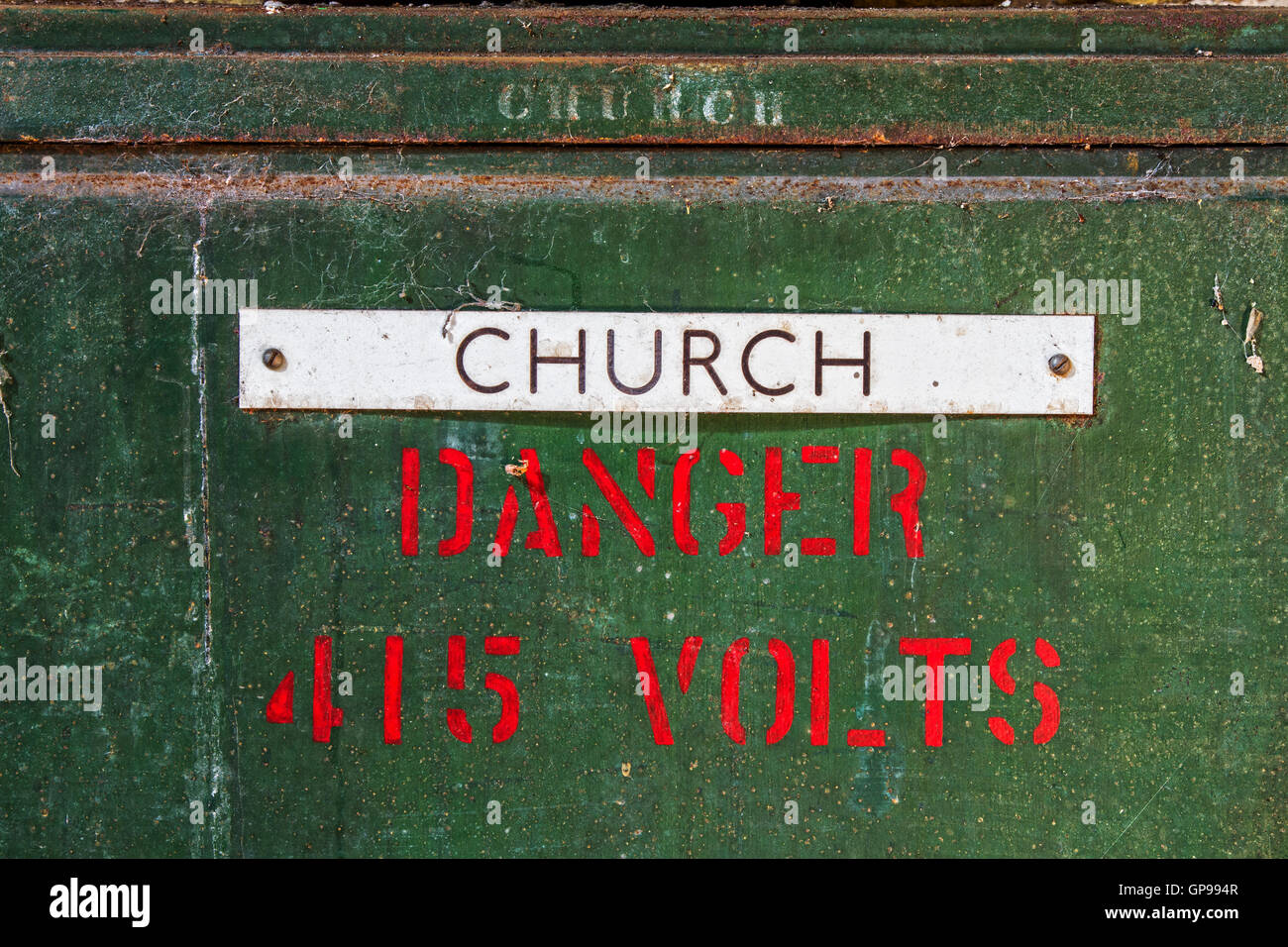 Comical image of a danger and church sign together inside Severalls Chapel, Colchester Essex, UK - Stock Image