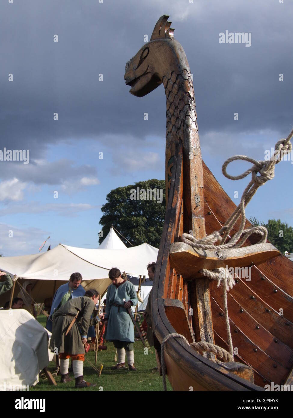 Vikings with longship - Stock Image