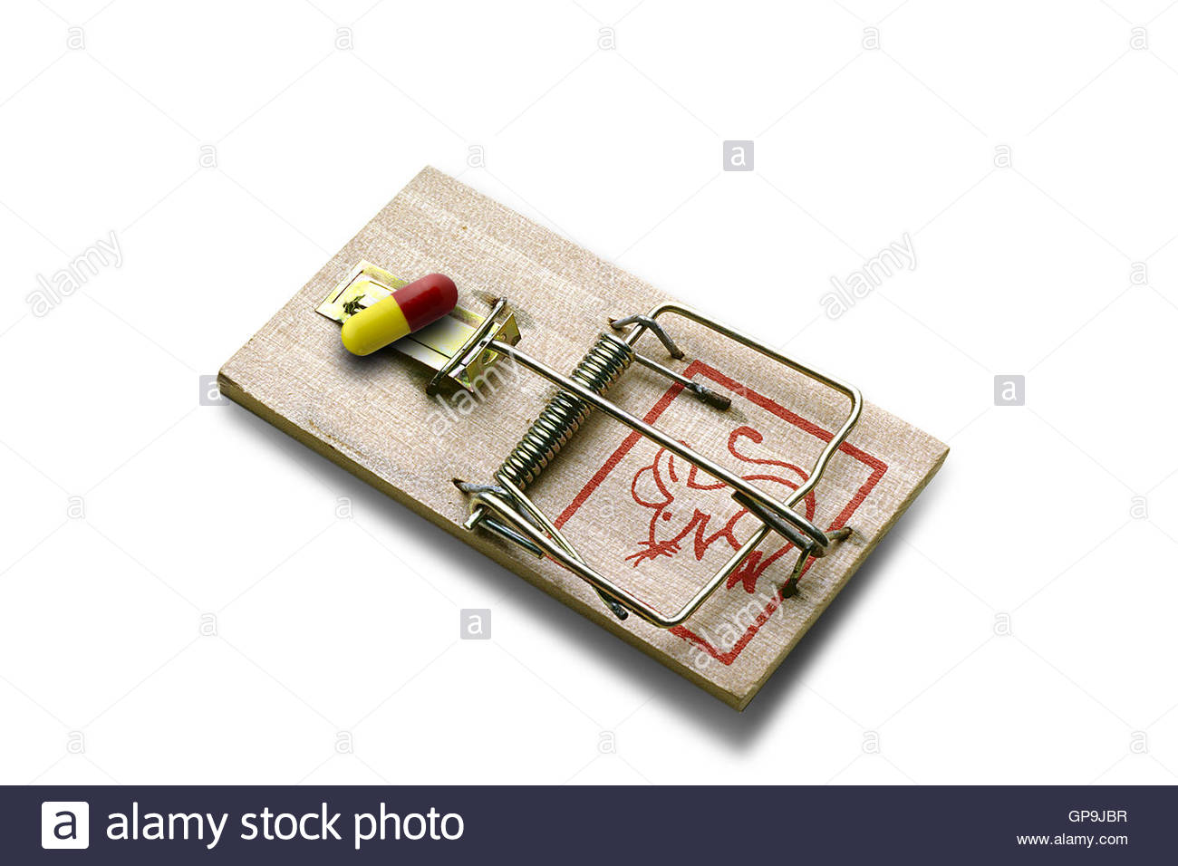Medical pill as bait on a mousetrap. - Stock Image