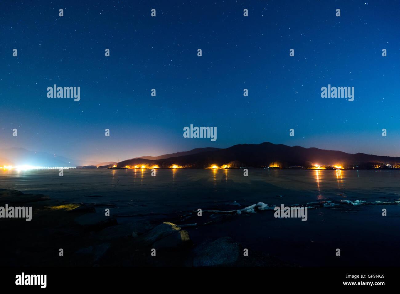 Korea,Night sky with lot of shiny stars at glacier in winter,Korea. - Stock Image