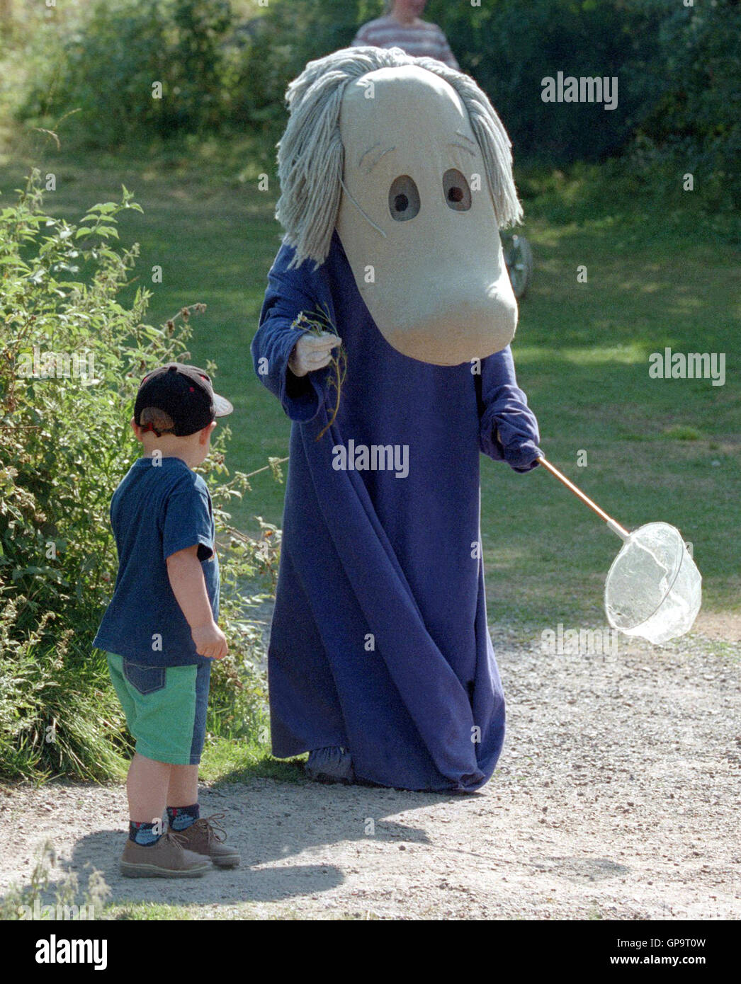 Moomin with children amused by characters from fairy tales Stock Photo
