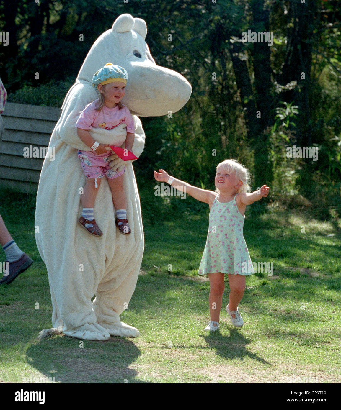 Moomin with children amused by characters from fairy tales - Stock Image