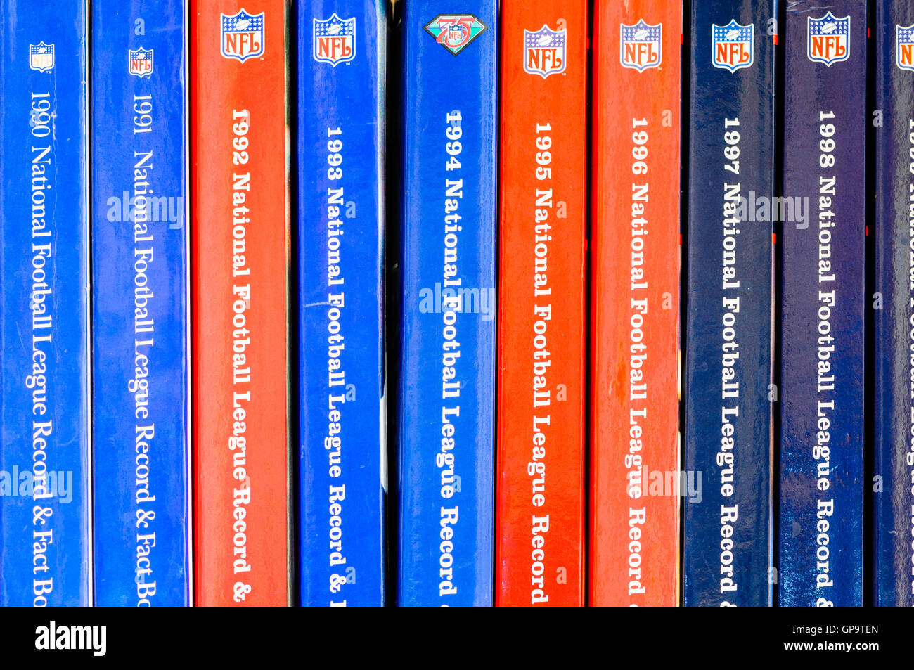 NFL official American Football yearbooks from the 1990s - Stock Image
