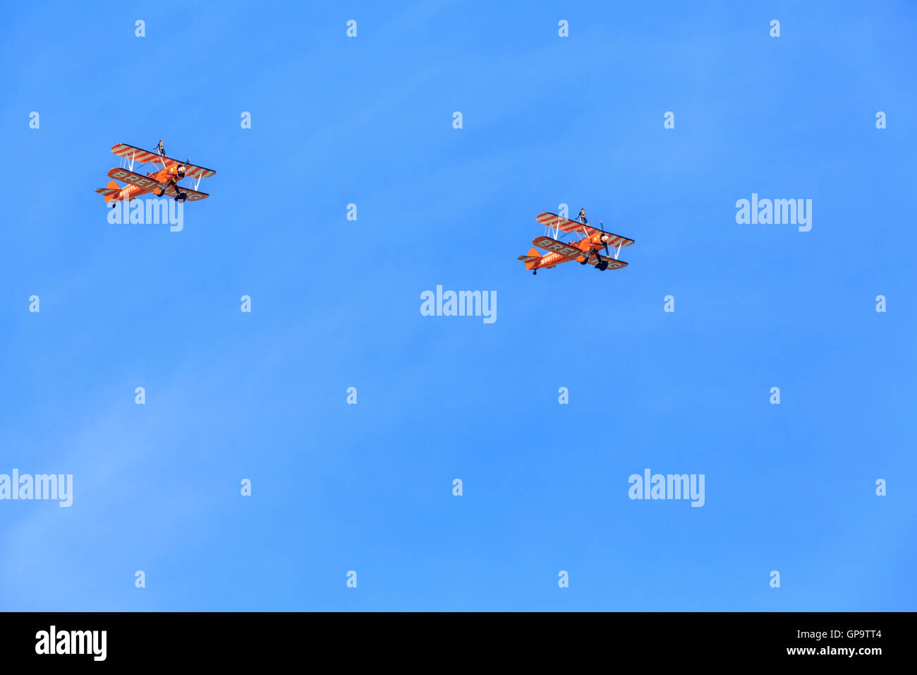 Eastbourne  International Airshow Airbourne  2 1940's Breiting Wingwalkers Boeing Stearman Biplanes fly over - Stock Image