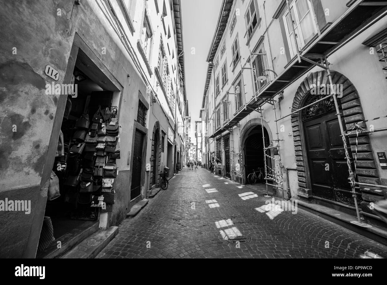 Black and white photograph of a street in the city of Lucca. - Stock Image