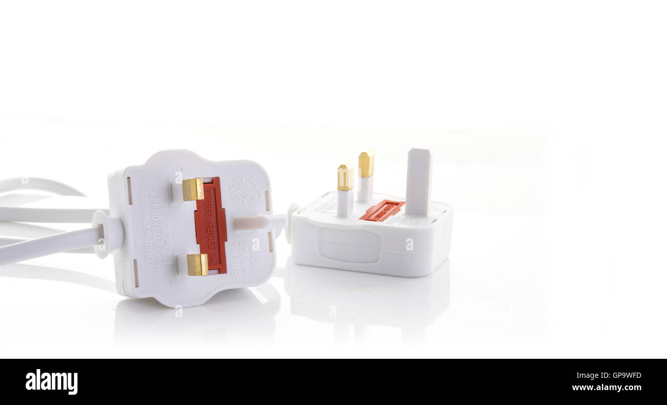 Two UK 13 amp electric plug on a white background with copy space - Stock Image
