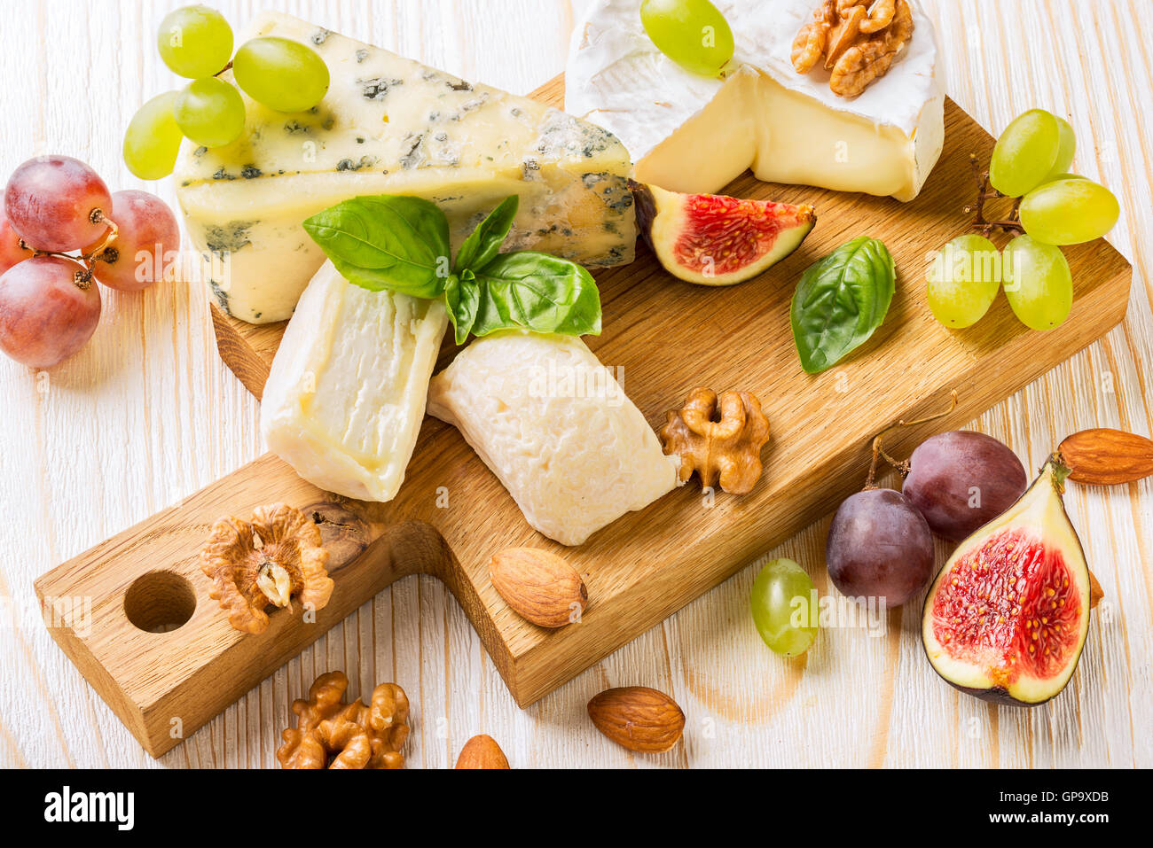 Cheese platter with figs, grapes and nuts - Stock Image