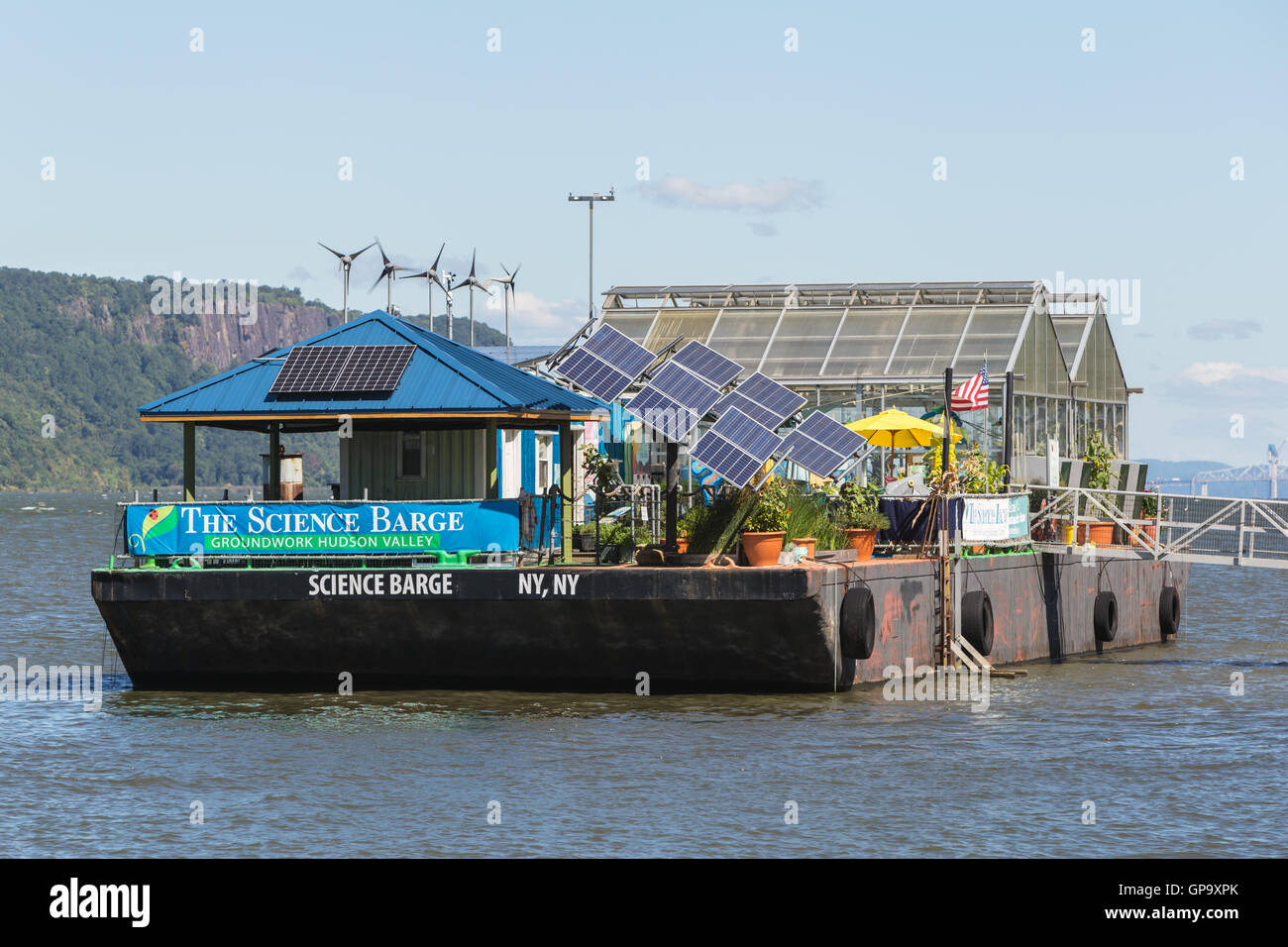 The Science Barge environmental education center anchored on the Hudson River on the waterfront of Yonkers, New - Stock Image