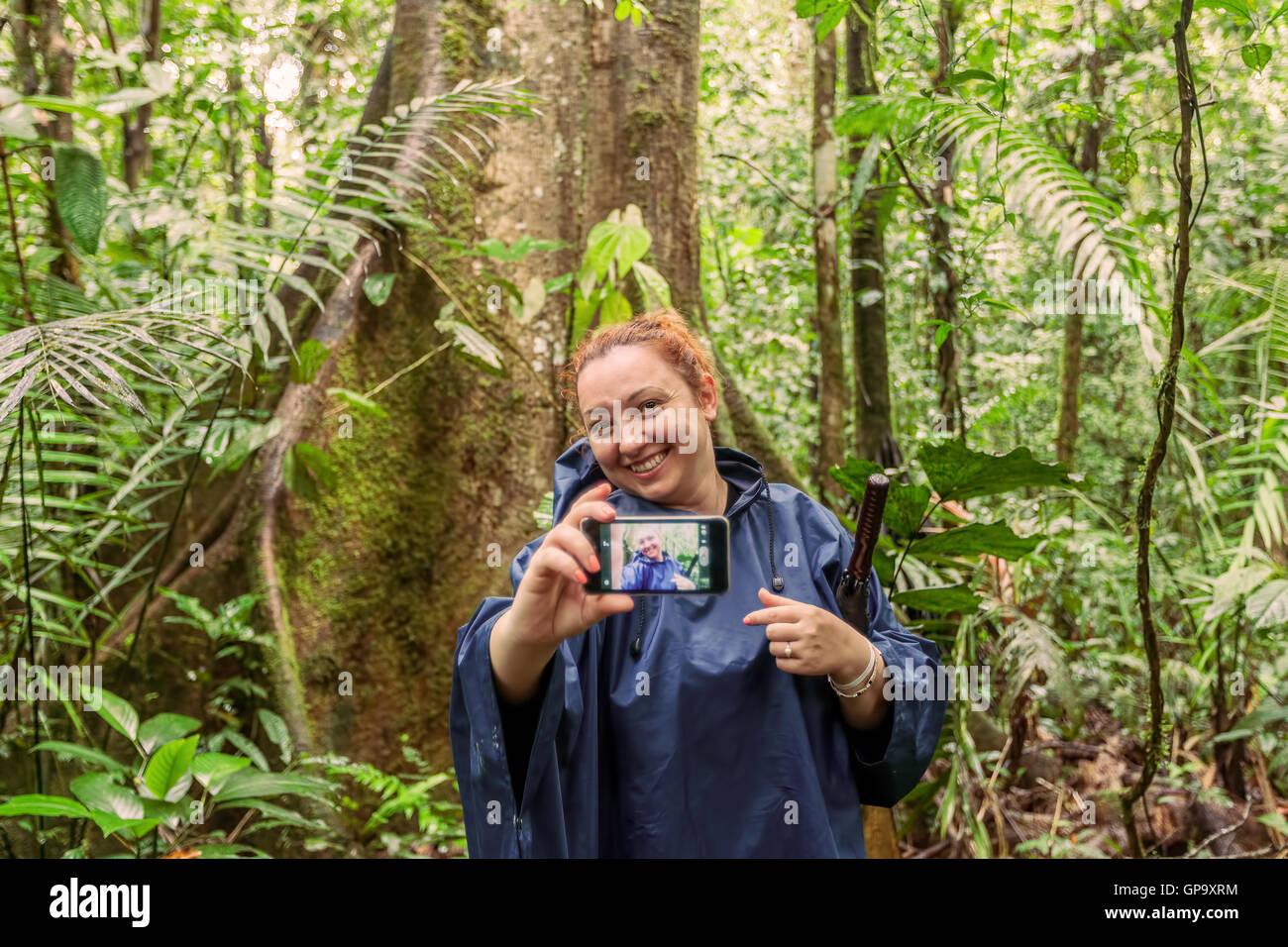 European Blonde Woman Exploring The Jungle Swamp In Cuyabeno National Park, South America - Stock Image