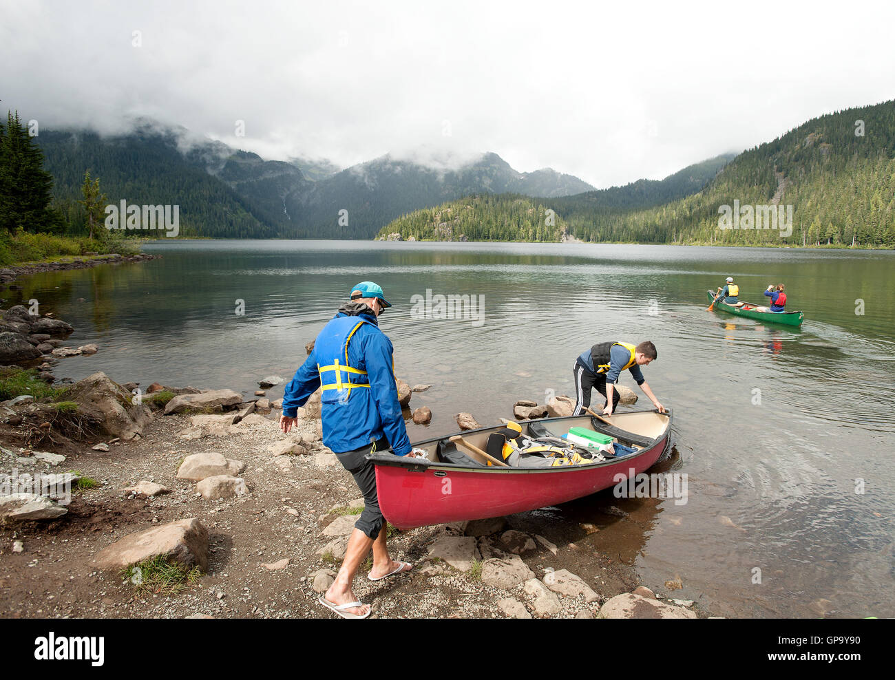 A group of canoe campers push off for a trip across Callaghan Lake Saturday afternoon.  Whistler BC, Canada - Stock Image