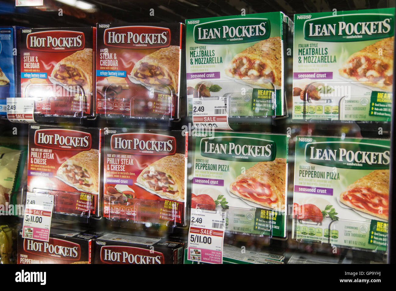 Boxes of Hot Pockets and Lean Pockets in the freezer case of a grocery store - Stock Image