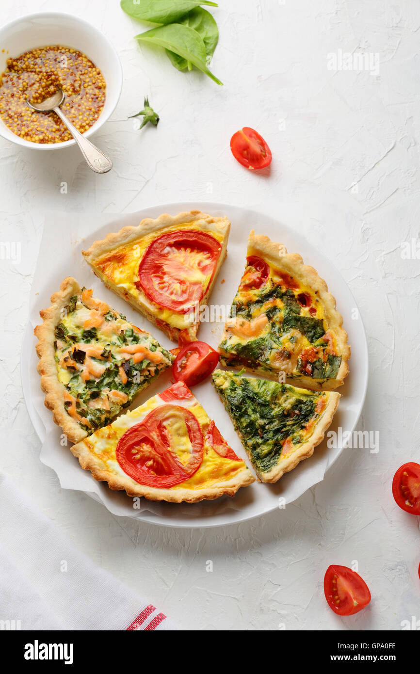 Slices of vegetables pie on plate, healthy food - Stock Image
