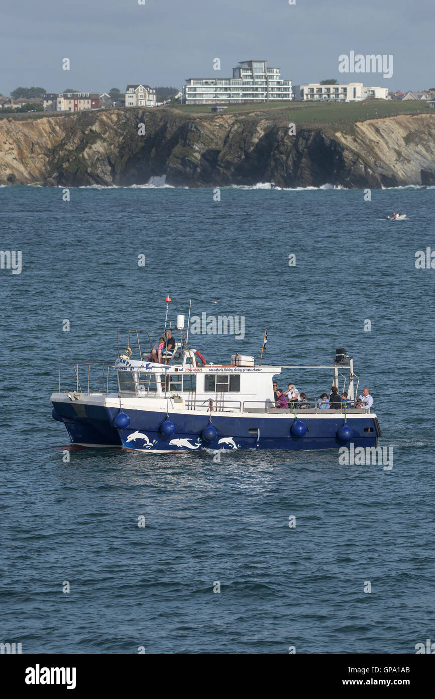 The Atlantic Explorer from Newquay steams around Towan Headland in Cornwall. - Stock Image