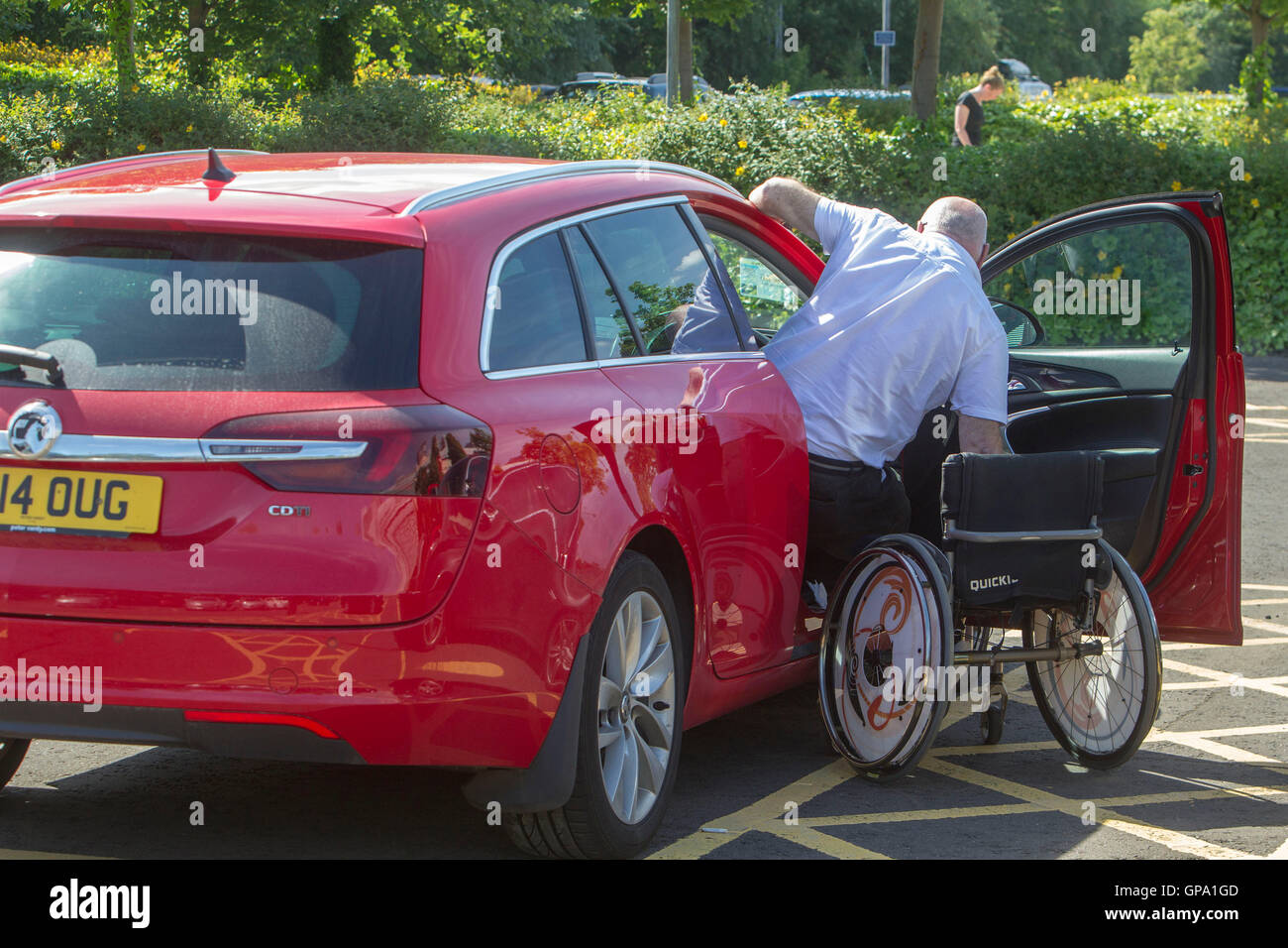 Disabled person using public transport - Stock Image