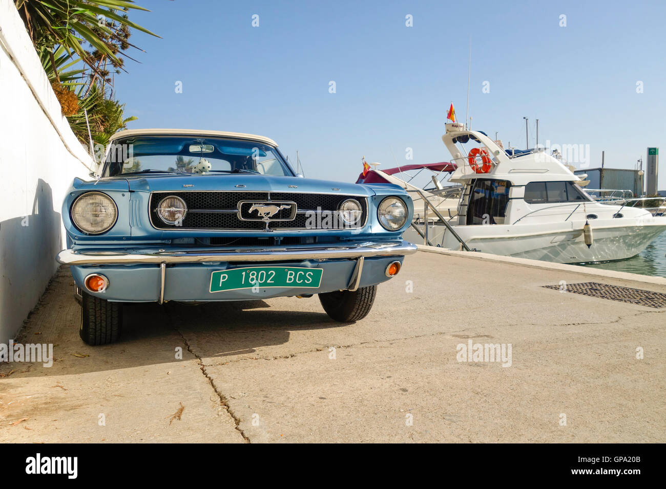 Ford Mustang Convertible 200, parked in luxury port, Cabopino, Spain. - Stock Image