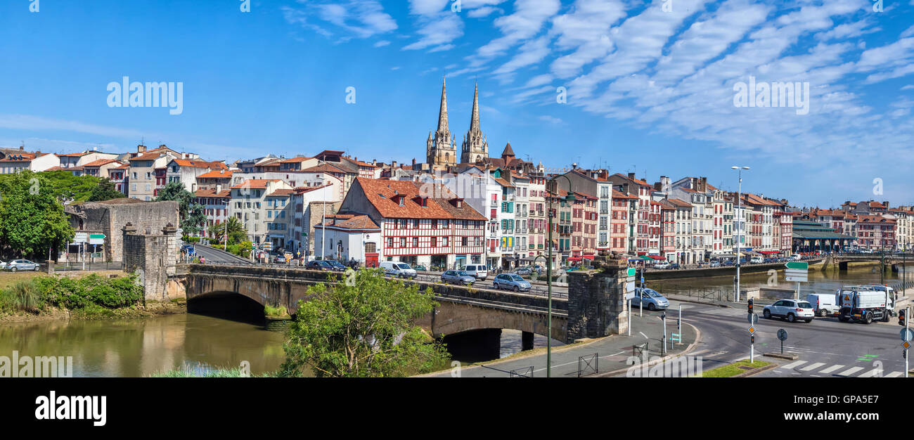Panorama of Bayonne with bridge Pont du Genie across the Nive river on the front view, Aquitaine, France - Stock Image