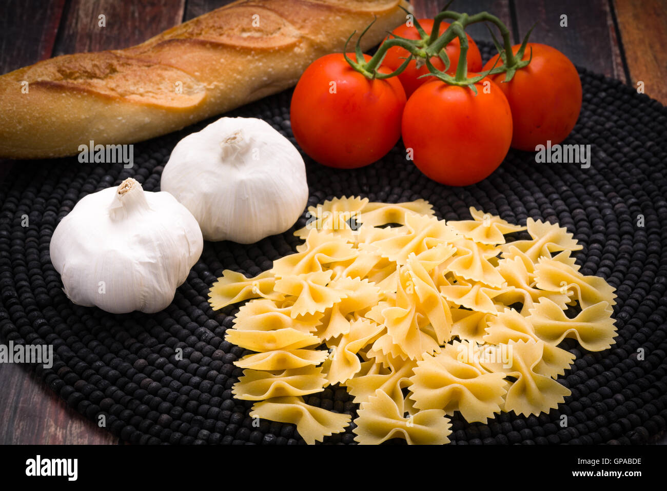 Bowtie pasta with vine ripened tomatoes and garlic - Stock Image