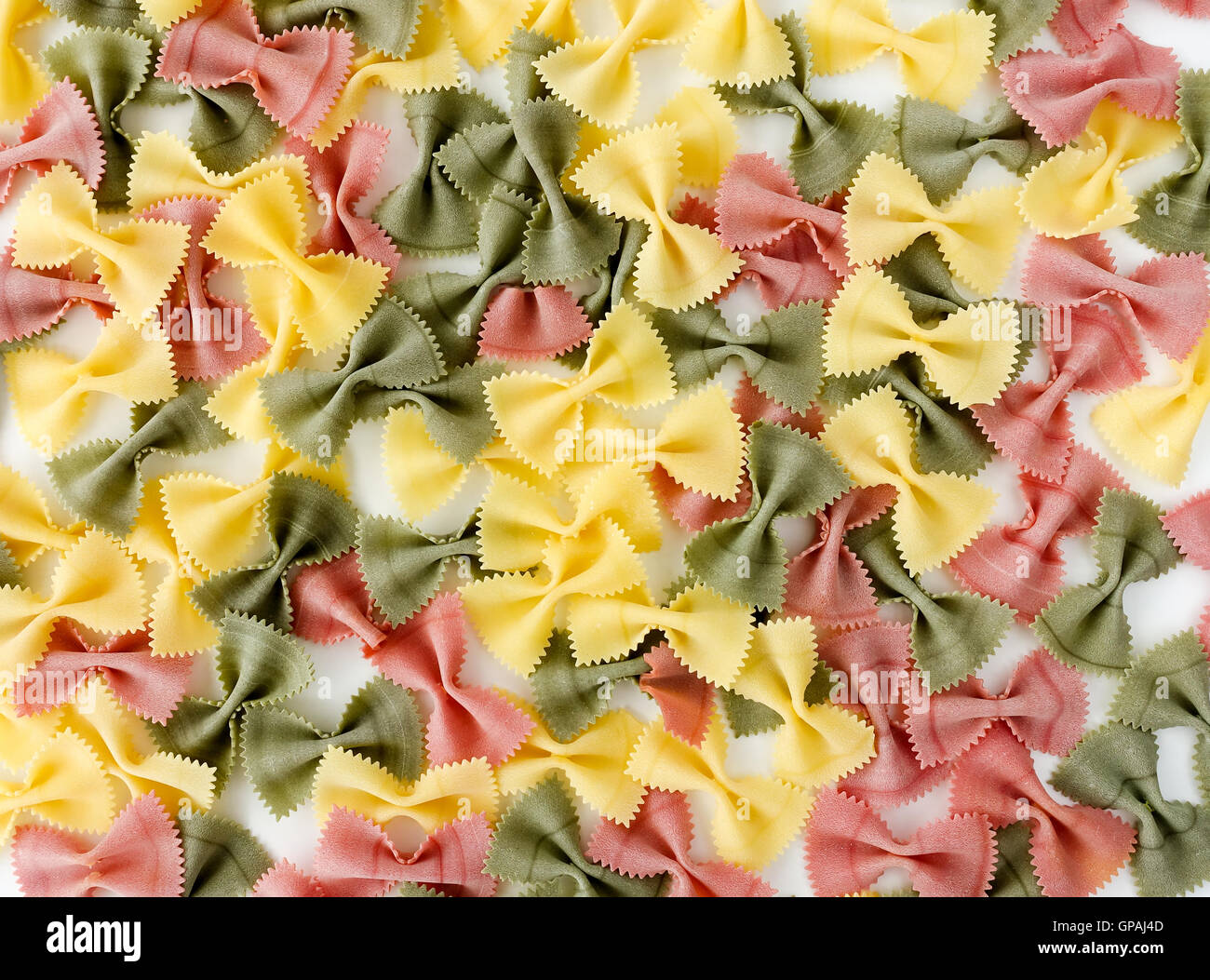 Multicolored Farfalle Pasta on White Background Stock Photo