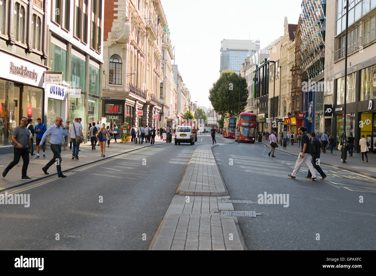 London, England, UK - 30 August 2016: Pedestrians cross Oxford street at early hours. Oxford road has around 300 - Stock Image