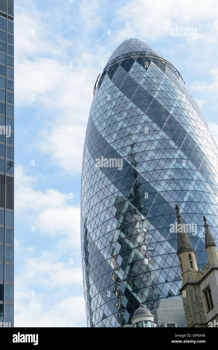 London, England - 31 August 2016: Urban landscape with the exterior of 30 St Mary Axe known as the Gherkin in the - Stock Image