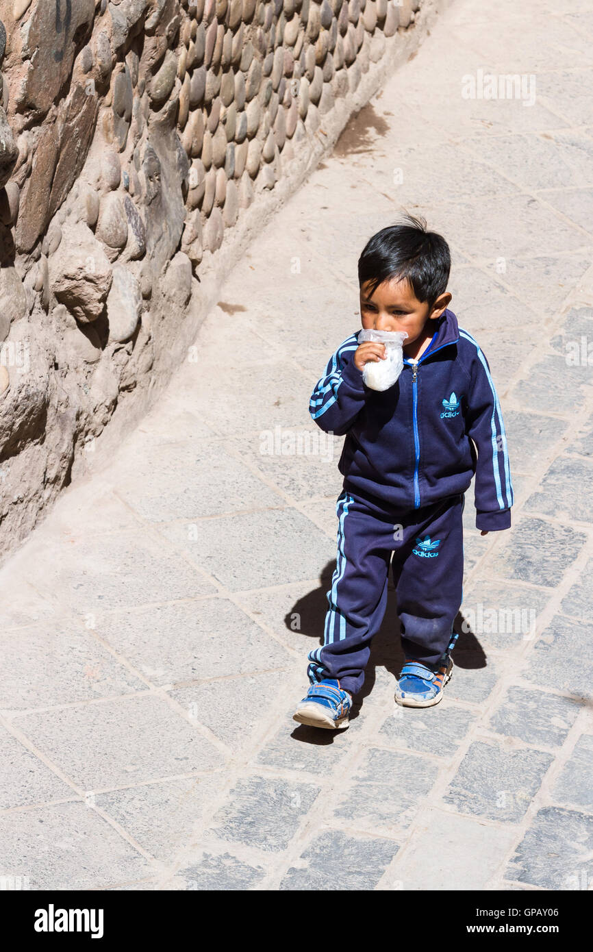 Pisac, Peru - May 15: Young boy walking dressed up in full Adidas clothing in the Sacred Valley Market. May 15 2016, - Stock Image