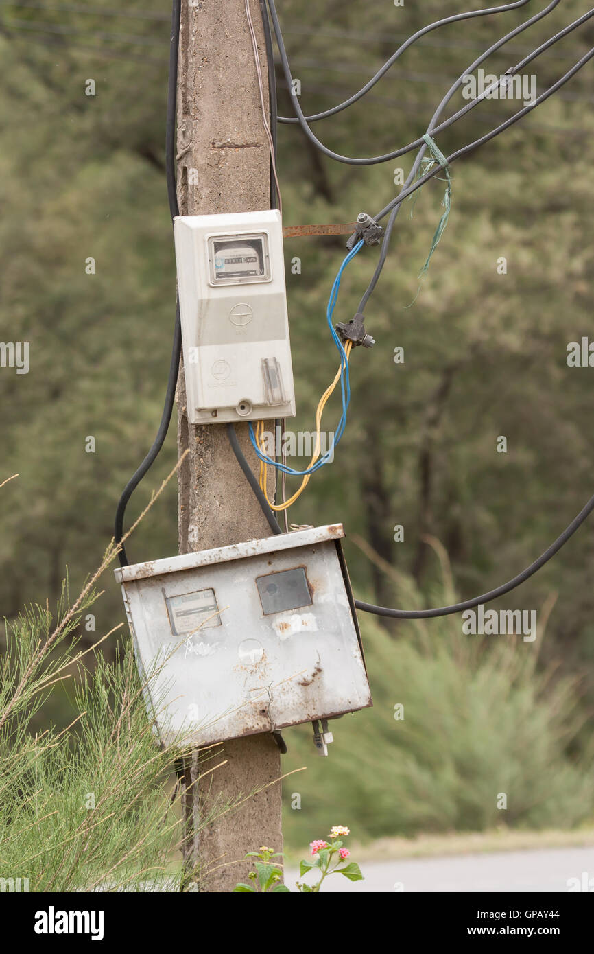 Cabinet with electrical meter on a concrete pole - Stock Image