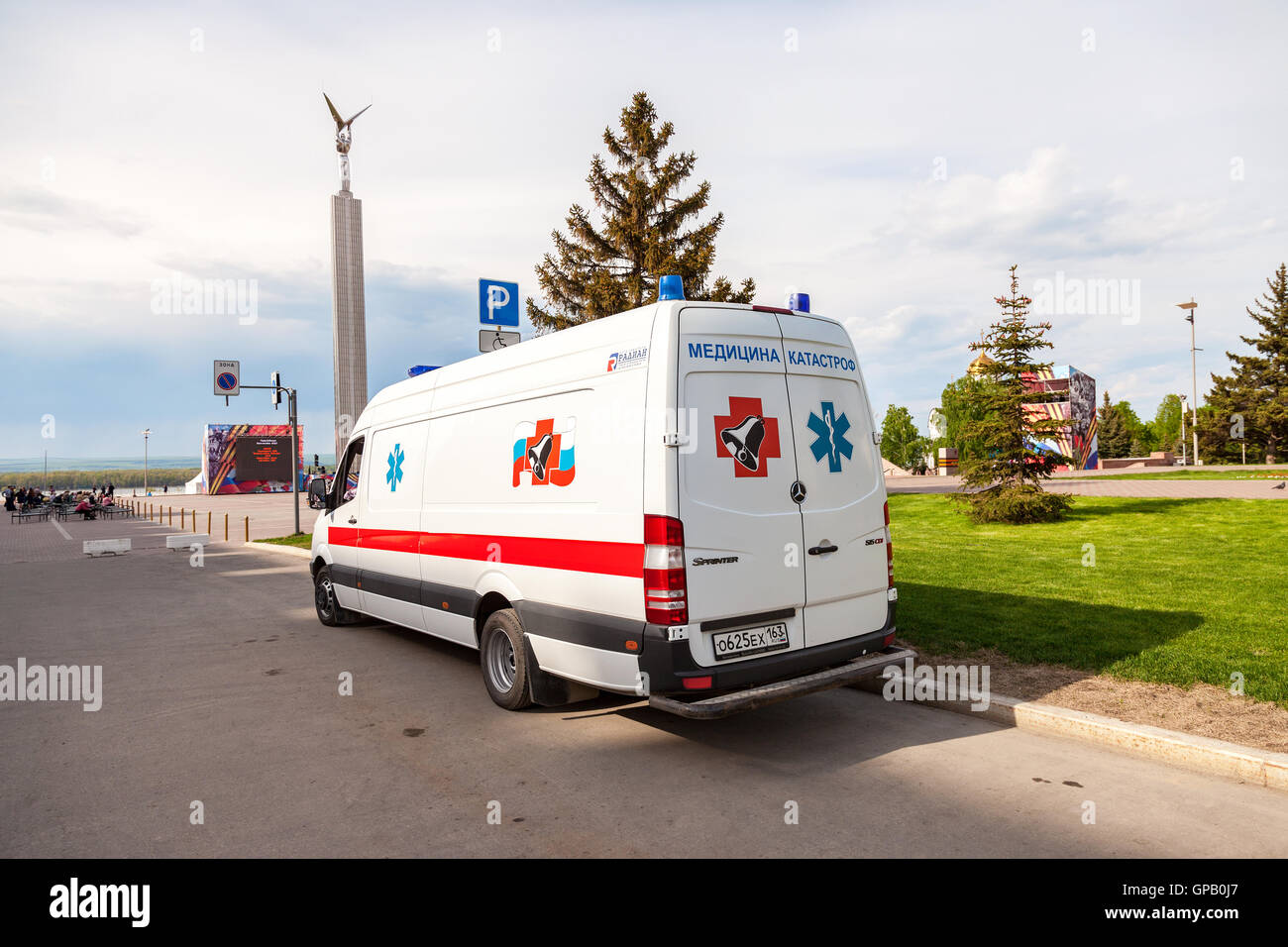 Ambulance car parked up in the street. Text in russian: 'Emergency Medicine' - Stock Image