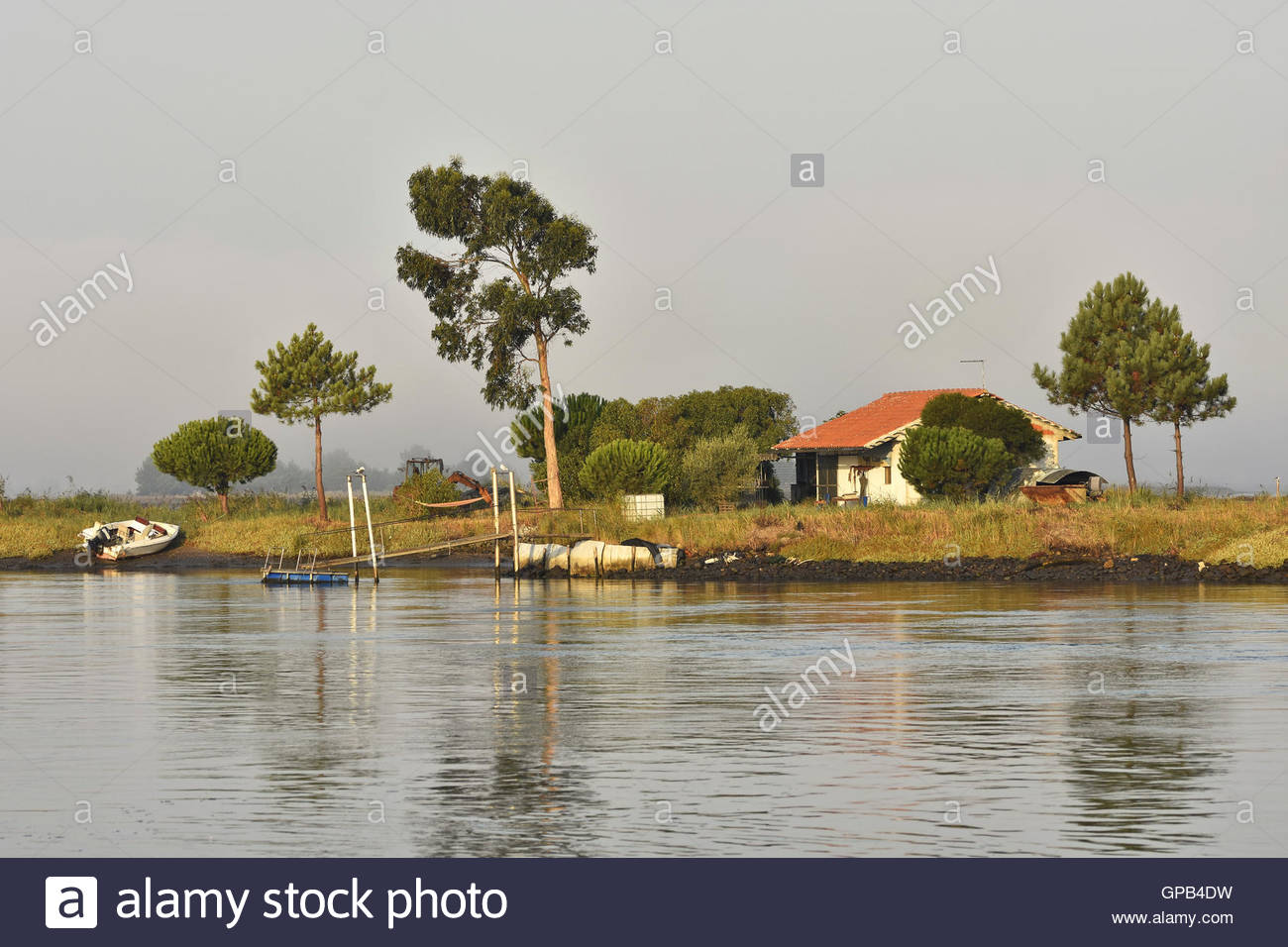 Riverside house and fishing boats in Aveiro Portugal Europe. Stock Photo