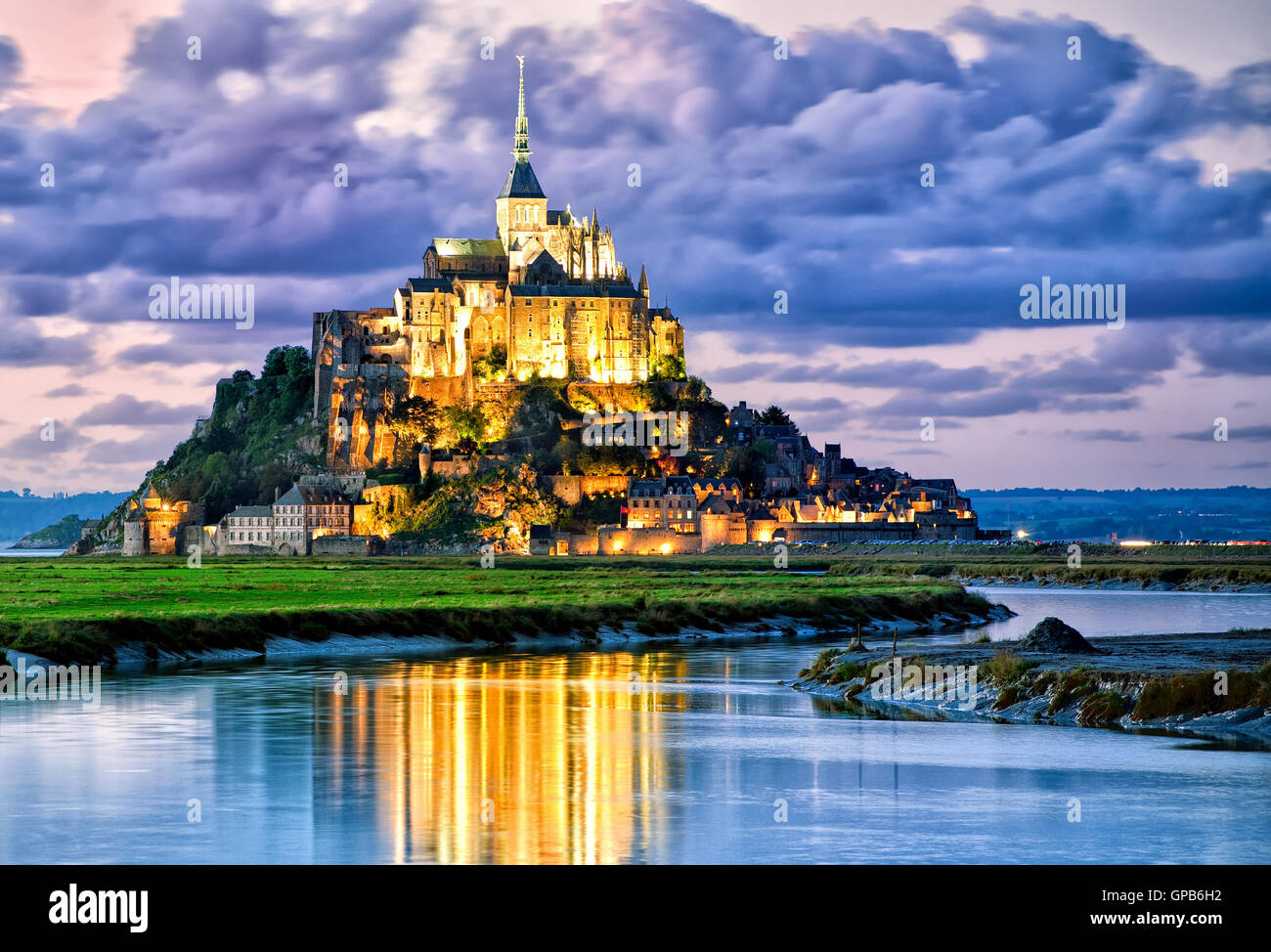 Mont Saint-Michel is one of France's most recognizable landmarks, listed on UNESCO list of World Heritage Sites. Stock Photo