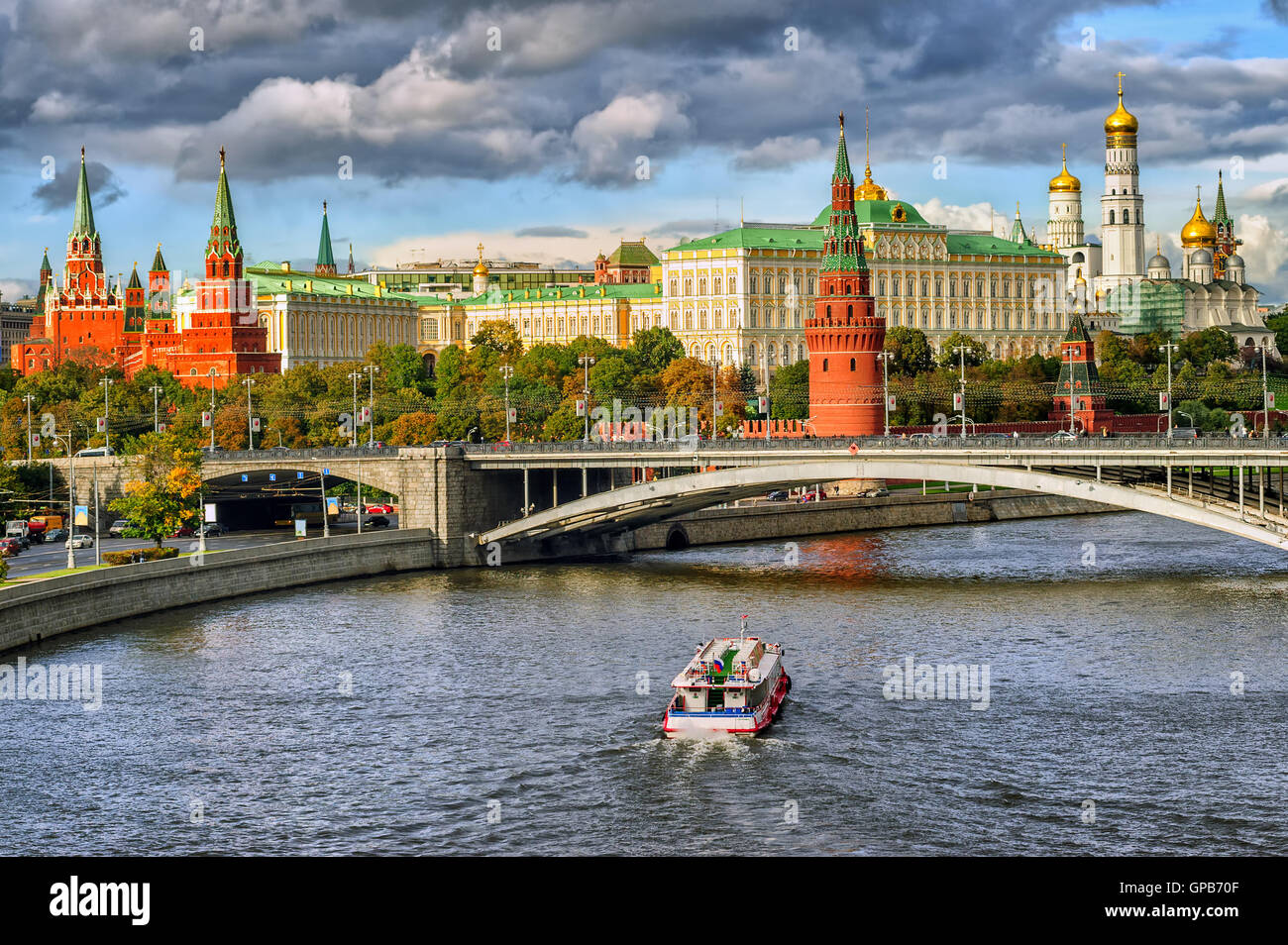Red and white towers of Moscow Kremlin over Moskva river, Moscow, Russia - Stock Image