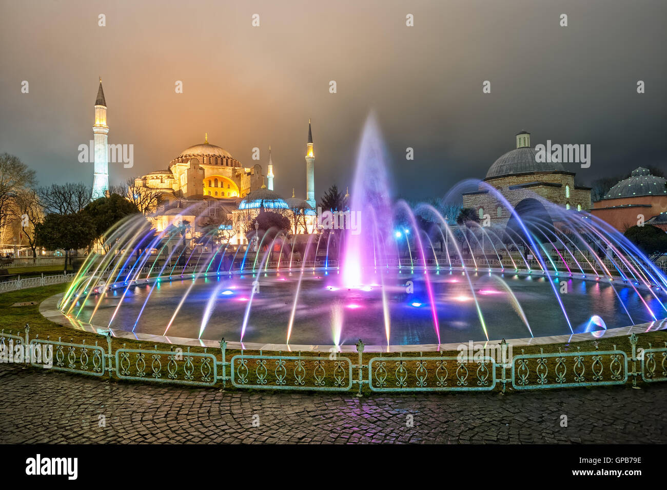 Hagia Sophia and colorful fountain in Sultanahmet park, Istanbul, Turkey, at late evening - Stock Image