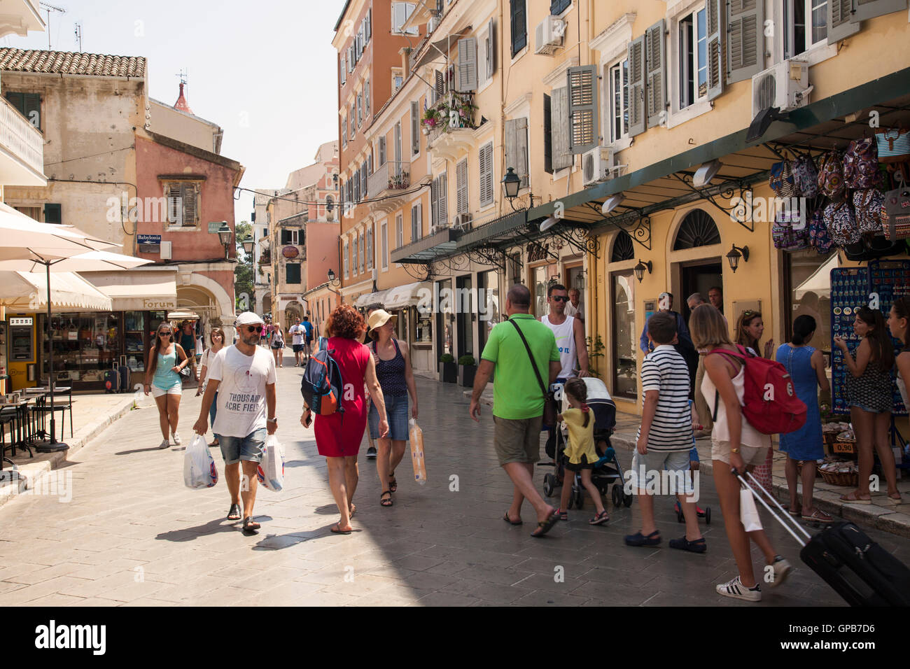 Holidaymakers sightseeing and shopping in Corfu town, Corfu, Greece - Stock Image