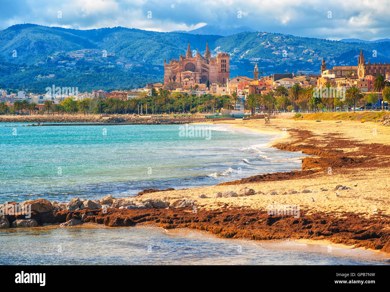 Sand beach in Palma de Mallorca, gothic cathedral La Seu in background, Spain - Stock Image