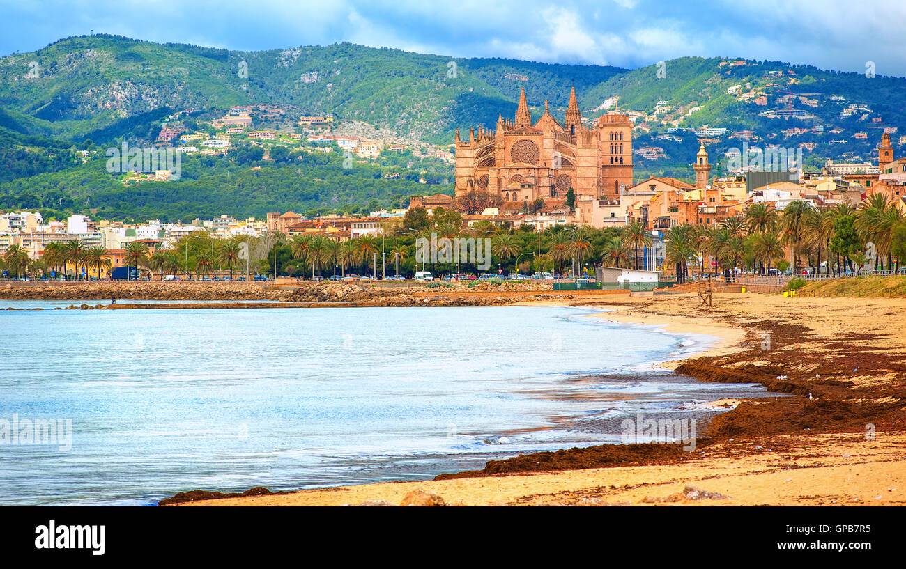Panoramic view of Palma beach with La Seu cathedral in background, Mallorca, Spain - Stock Image
