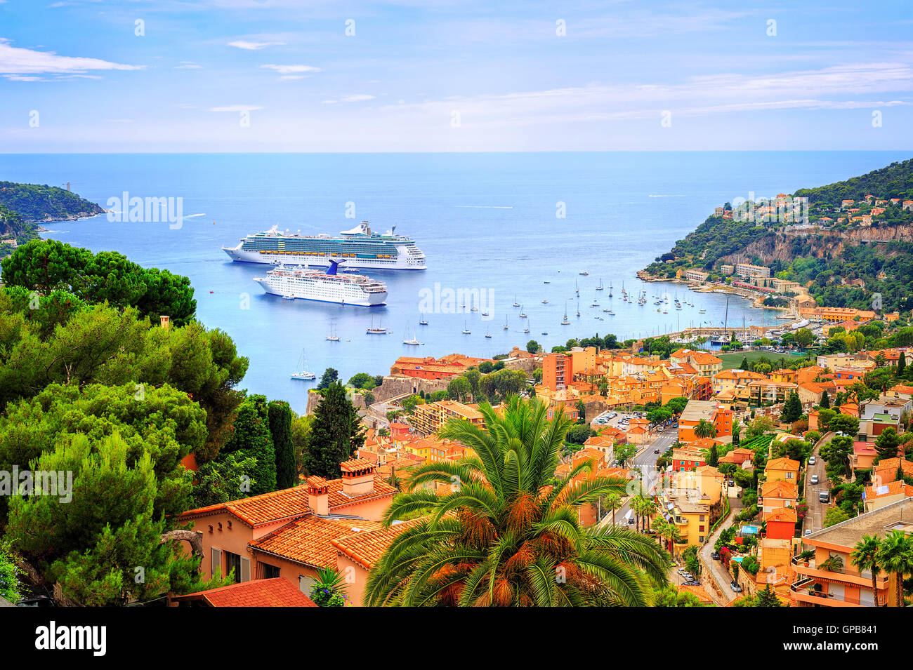 Cruising ships in a lagoon of Villefranche on french Riviera by Nice, France - Stock Image