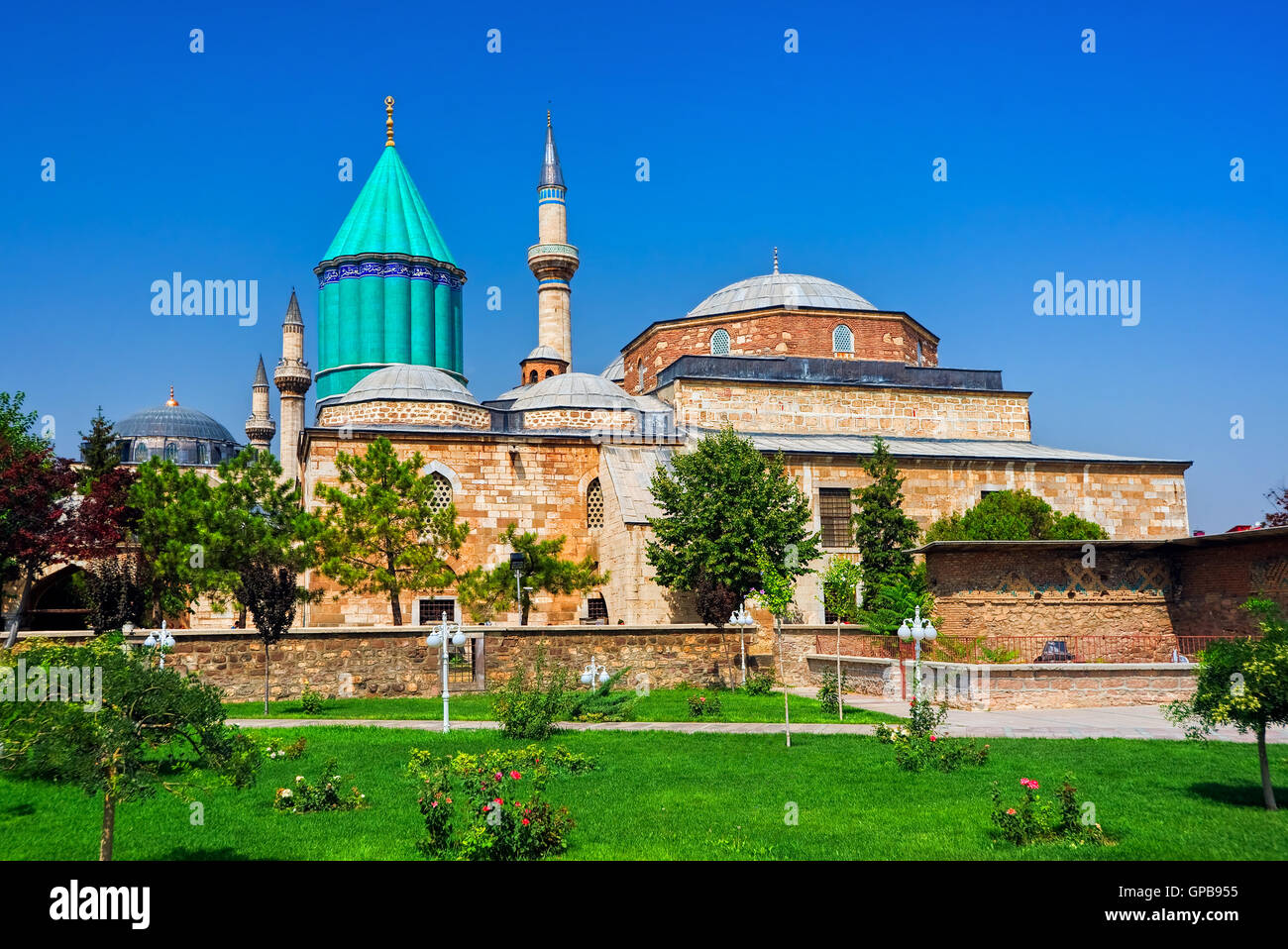 Tomb of Mevlana, the founder of Mevlevi sufi dervish order, with prominent green tower in Konya, Turkey - Stock Image