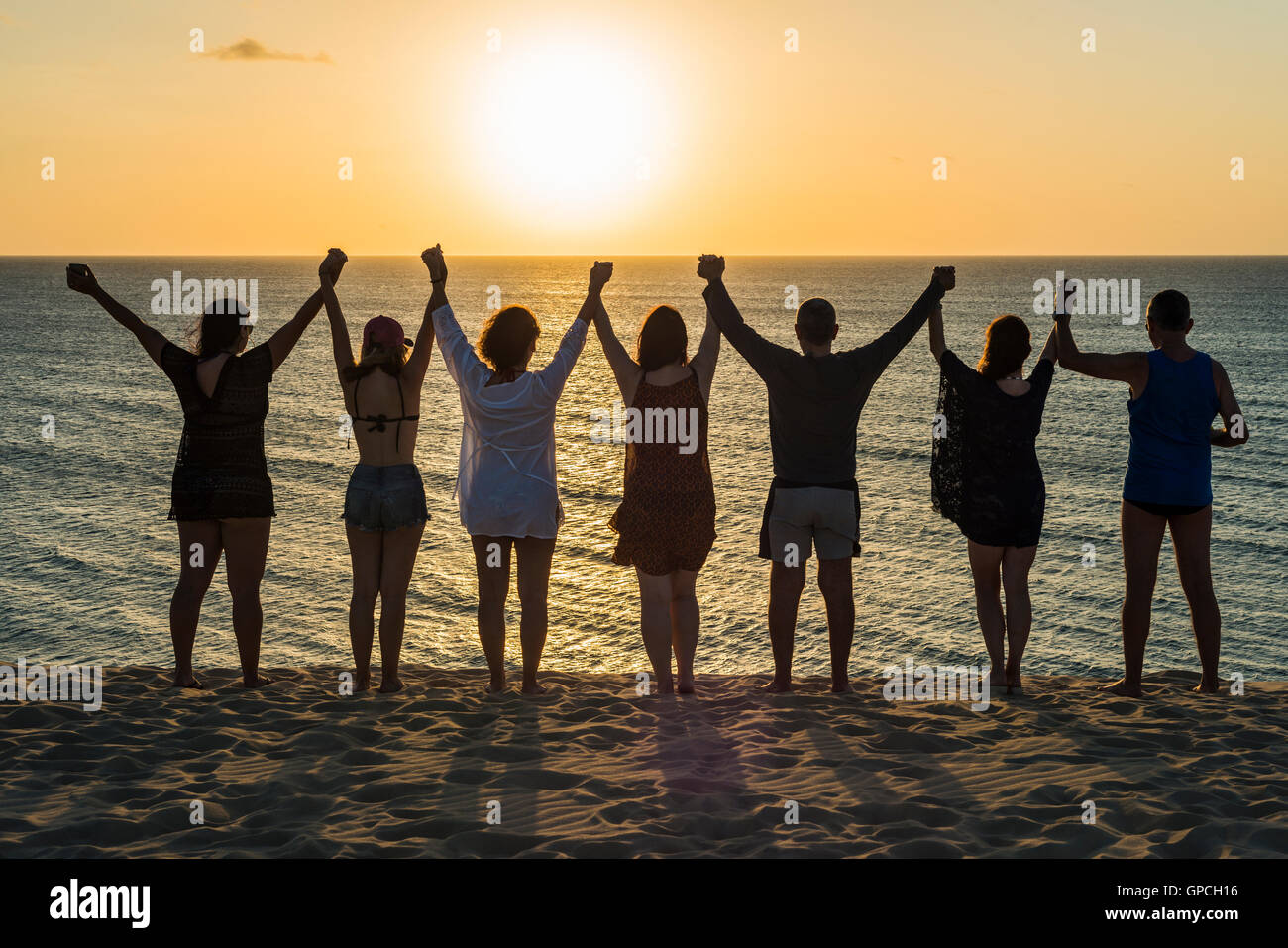 Tourists traditional farewell to the sun in Jericoacoara, Ceara state, Brazil Stock Photo