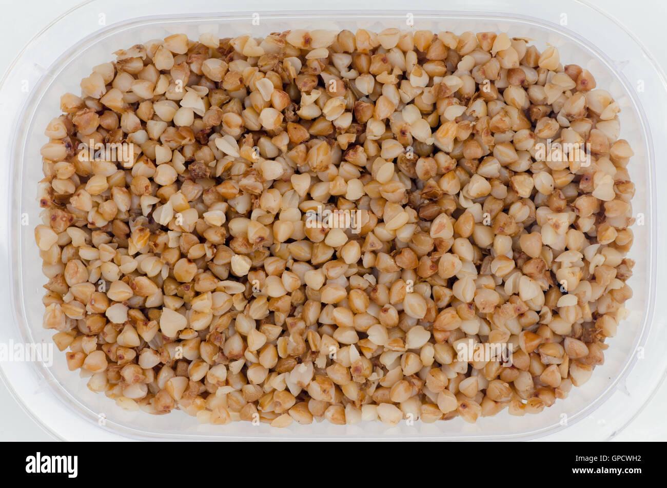 closeup to buckwheat in plastic box - Stock Image