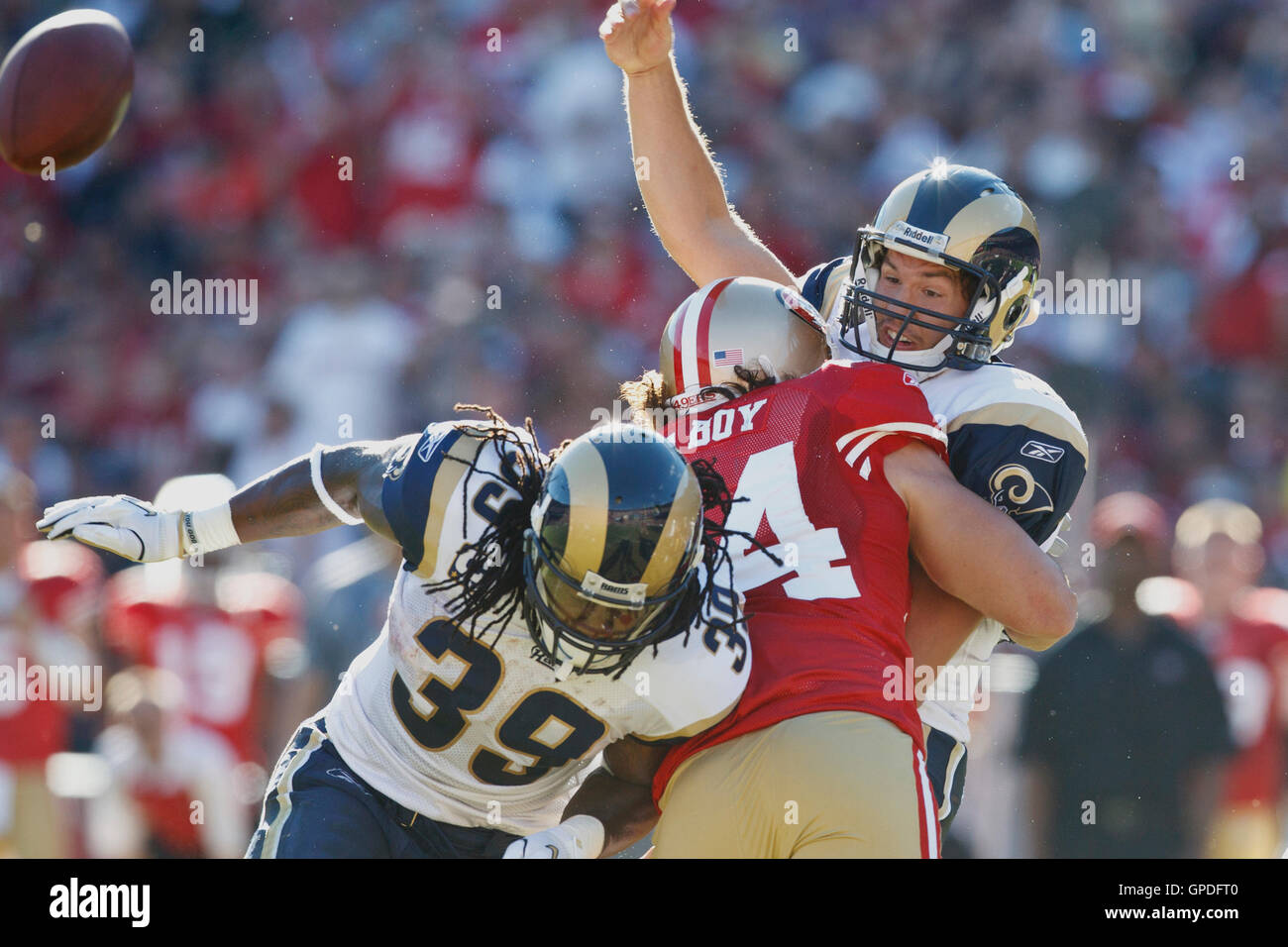 November 14, 2010; San Francisco, CA, USA;  St. Louis Rams quarterback Sam Bradford (8) is hit by San Francisco - Stock Image