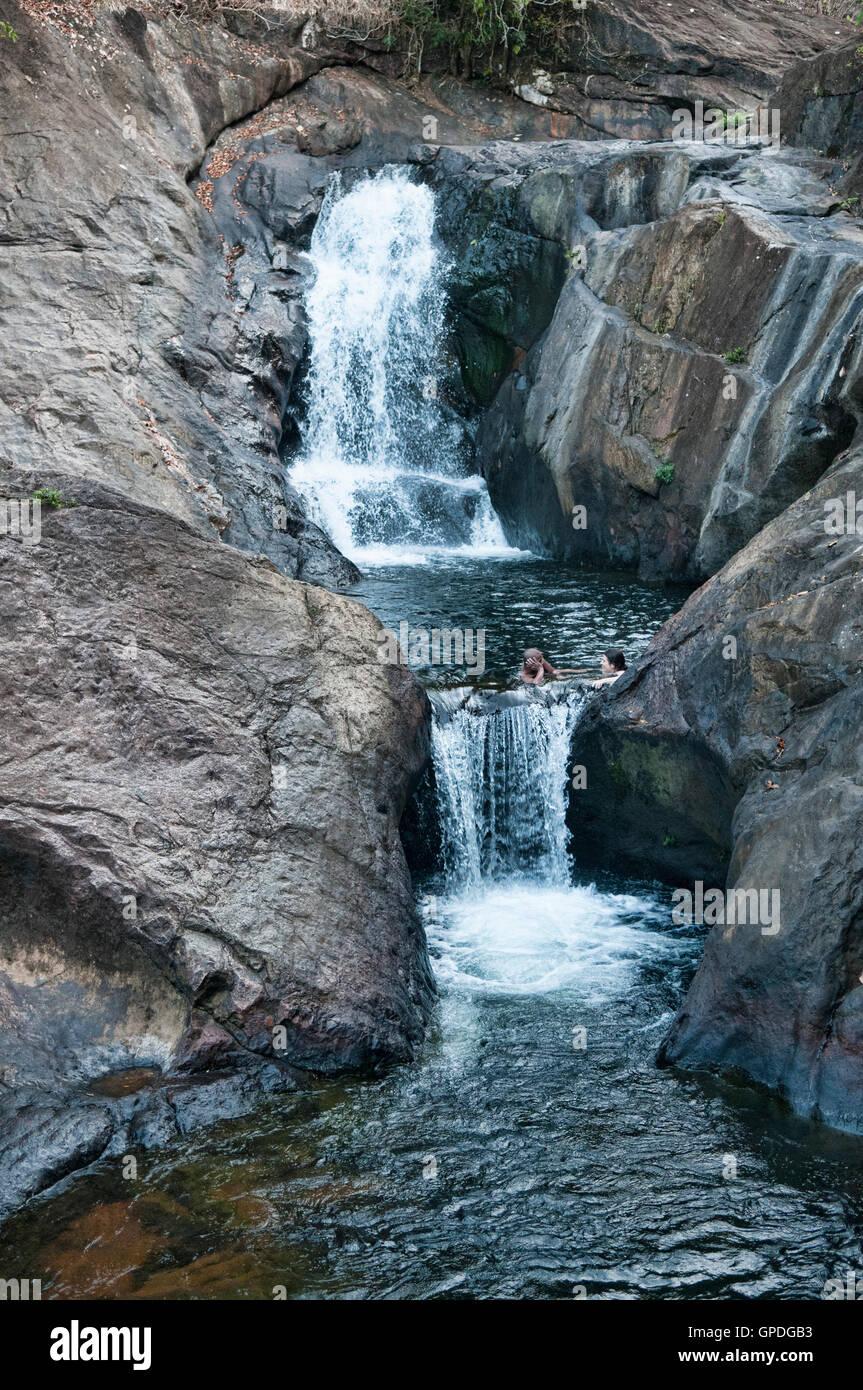 Enjoying the Than Mayom waterfall on Koh Chang island, Thailand - Stock Image