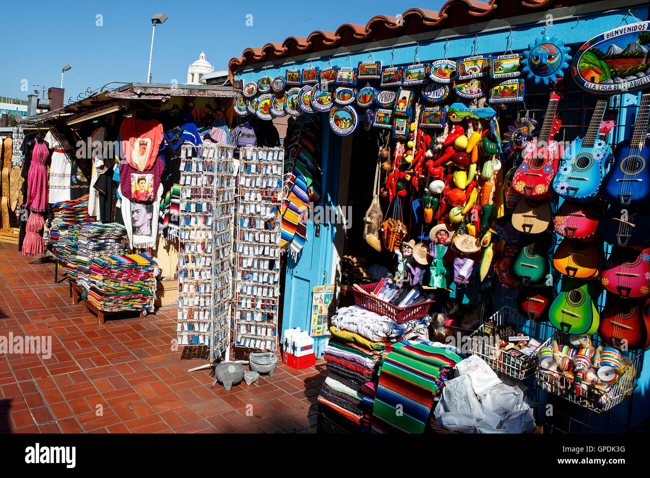 Souvenirs for sale in the market on Olivera Street, Los Angeles, California, United States of America - Stock Image